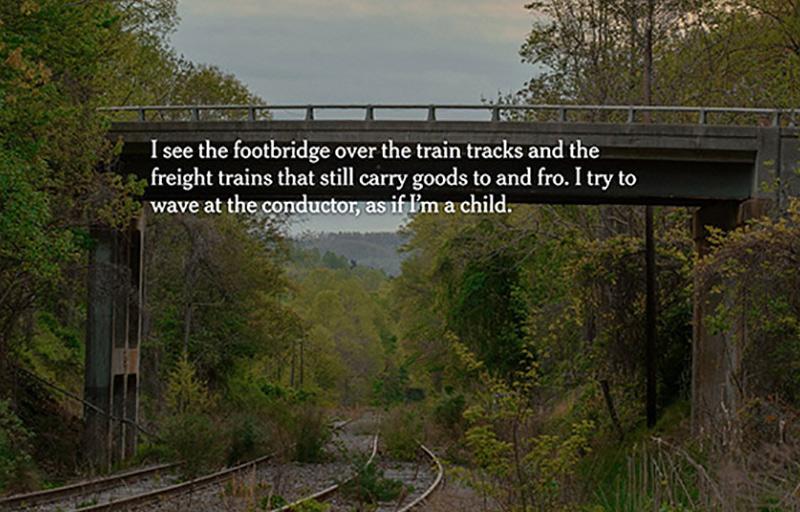 footbridge over train tracks in country setting
